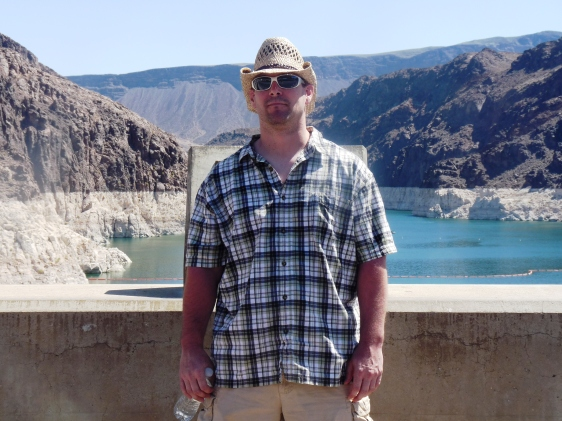 The author standing on top of Hoover Dam in Arizona and Nevada